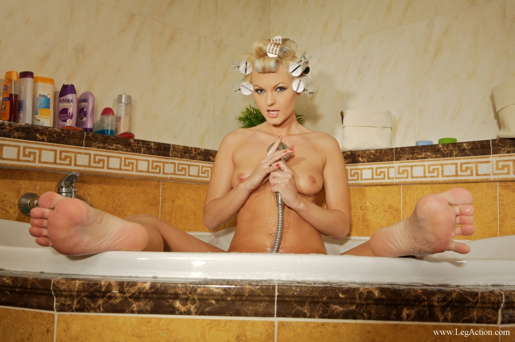 Sandra Scarlett rocks the bath with her long legs, soft sexy feet and thick dildo.